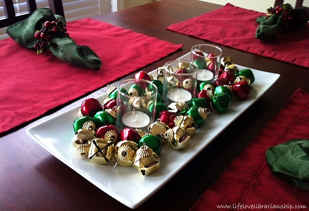 A Pinterest-inspired centerpiece. I love the jingle bells!